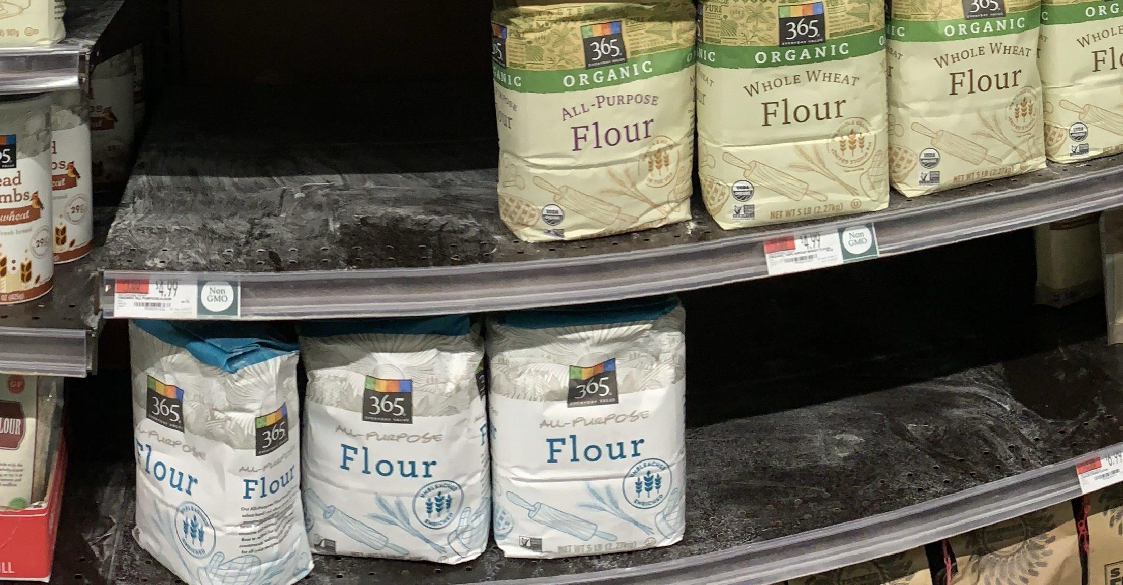 half empty shelf of bags of flour